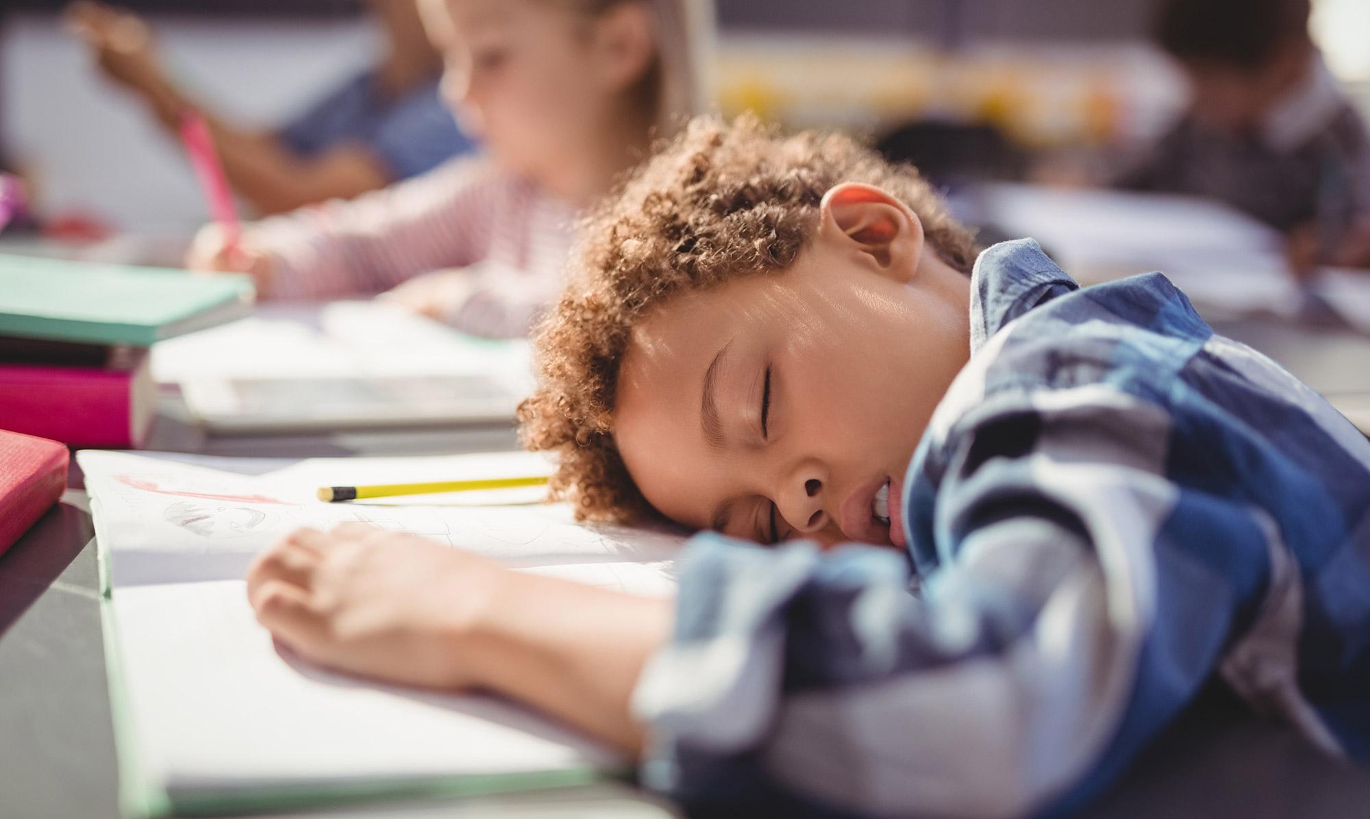 Child Asleep Head On Desk